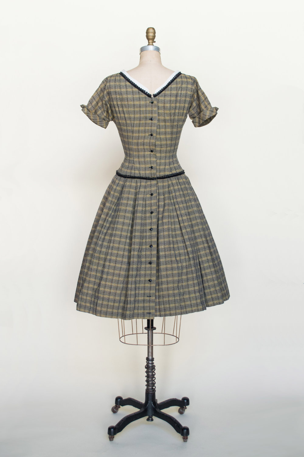 A 1950s plaid dress from Dalena Vintage, an Austin vintage clothing shop.
