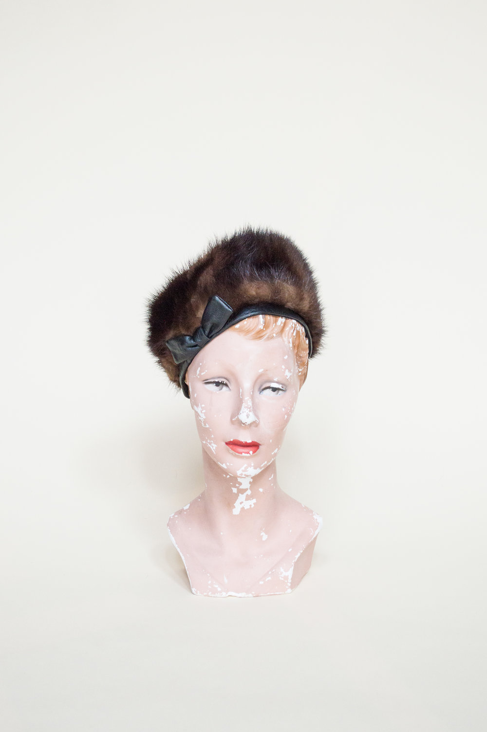 A vintage fur hat perfect for the holidays from Dalena Vintage.