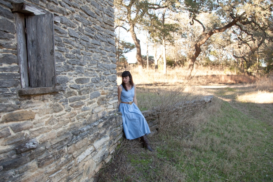 Leslie of Dalena Vintage exploring the old smokehouse at Kreische Brewery in La Grange, Texas.