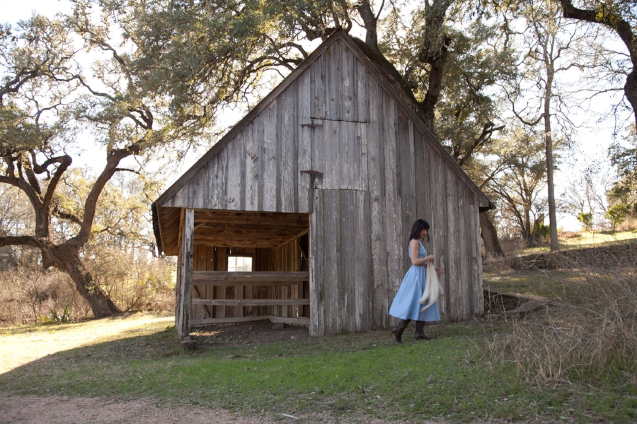 Leslie of Dalena Vintage exploring the barn at Kreische Brewery in La Grange, Texas.