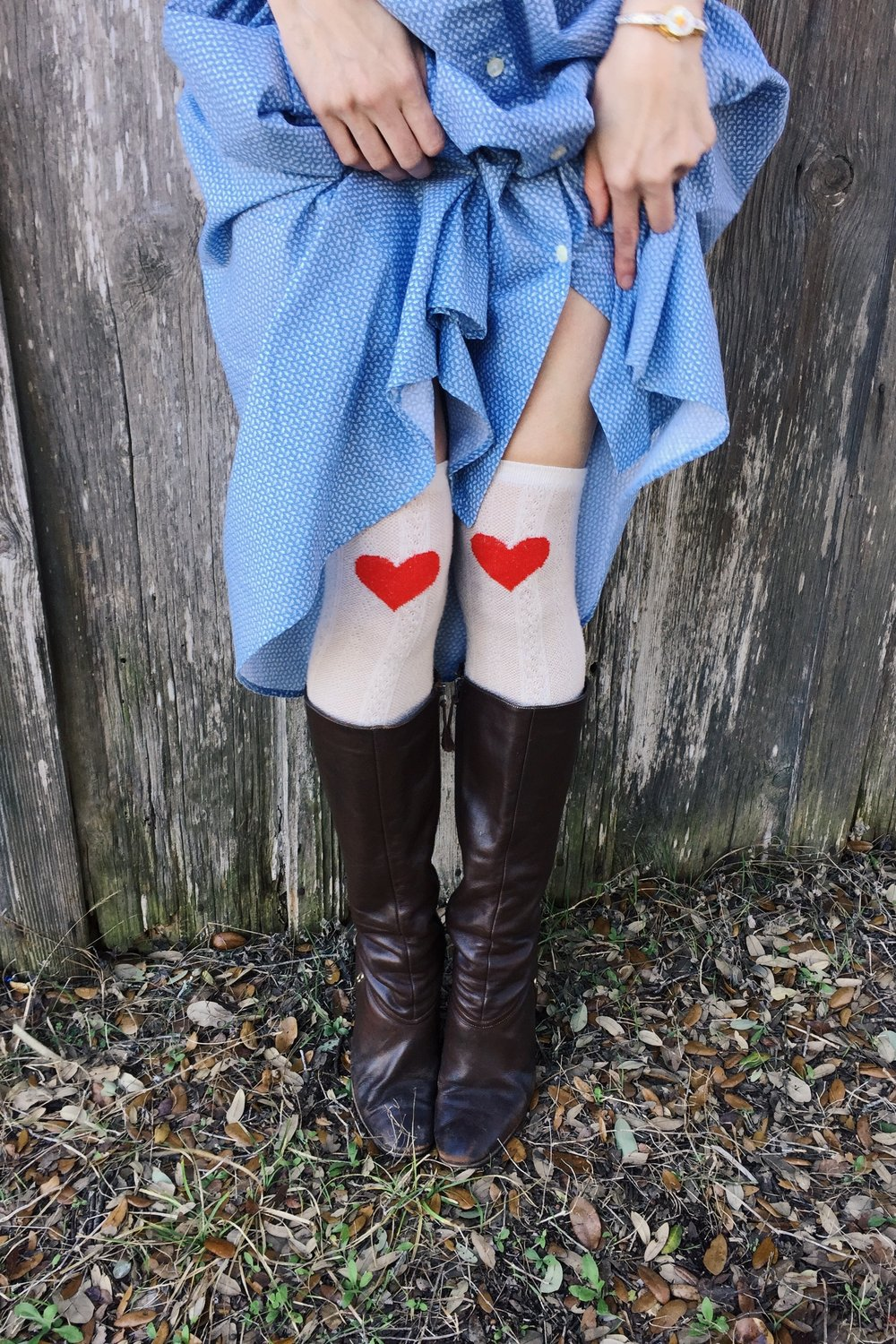 Leslie of Dalena Vintage in a pair of heart socks from Urban Outfitters.