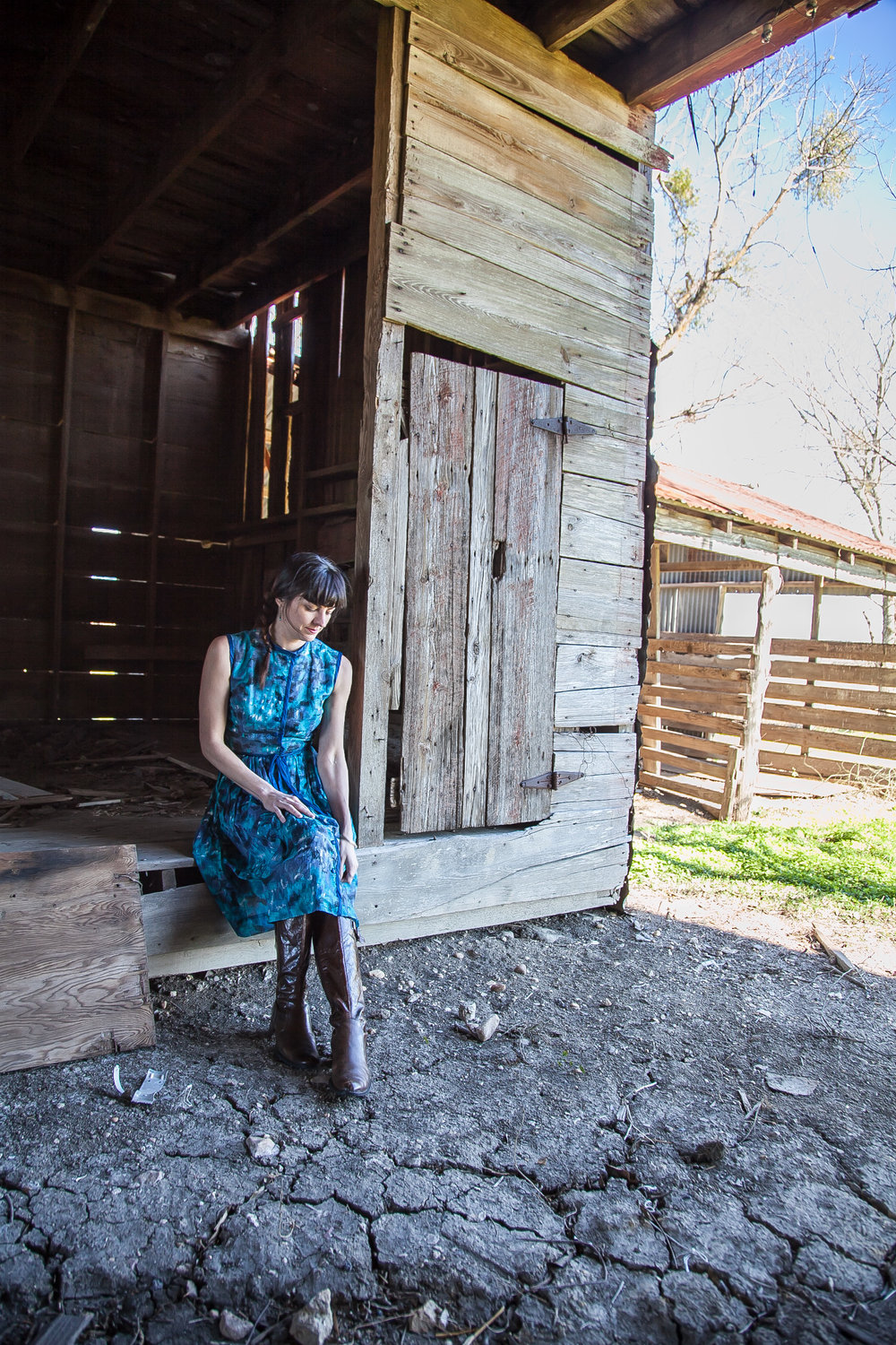 Leslie of Dalena Vintage exploring the Texas countryside in a 1950s dress and 1970s shawl from her shop, Dalena Vintage.
