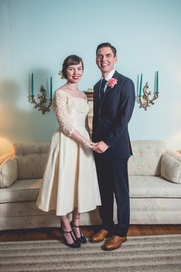 DV customer Corinne on her wedding day in a 1950's tea length wedding dress from the Dalena Vintage Bridal Collection.