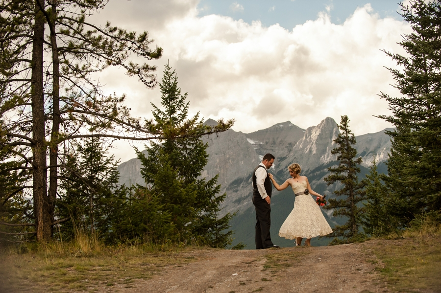 DV customer on her wedding day in a 1950's tea length wedding dress from the Dalena Vintage Bridal Collection taken in the Canadian Rockies.