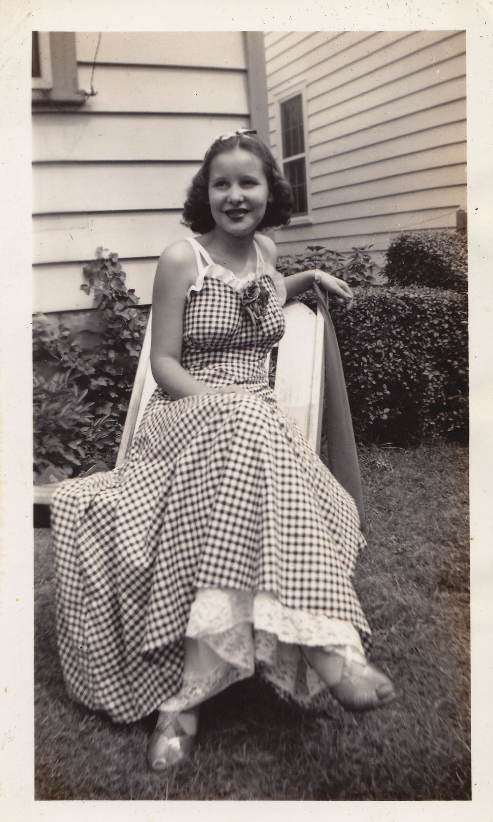 Nonchalantly posing in the yard pre-prom, spring 1939. This 1930's dance dress with a long, flown skirt is such a classic style for the era.   Found here.