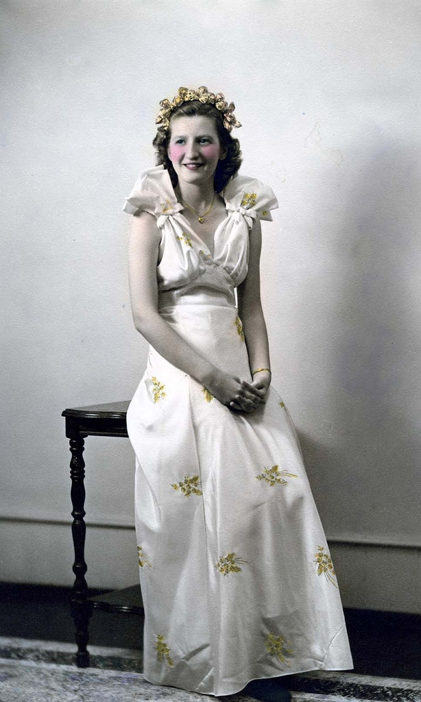Evelyn Andrews in her prom dress circa mid 1930's. Such a beautifully color tinted photo not to mention those shoulders!   Found here.