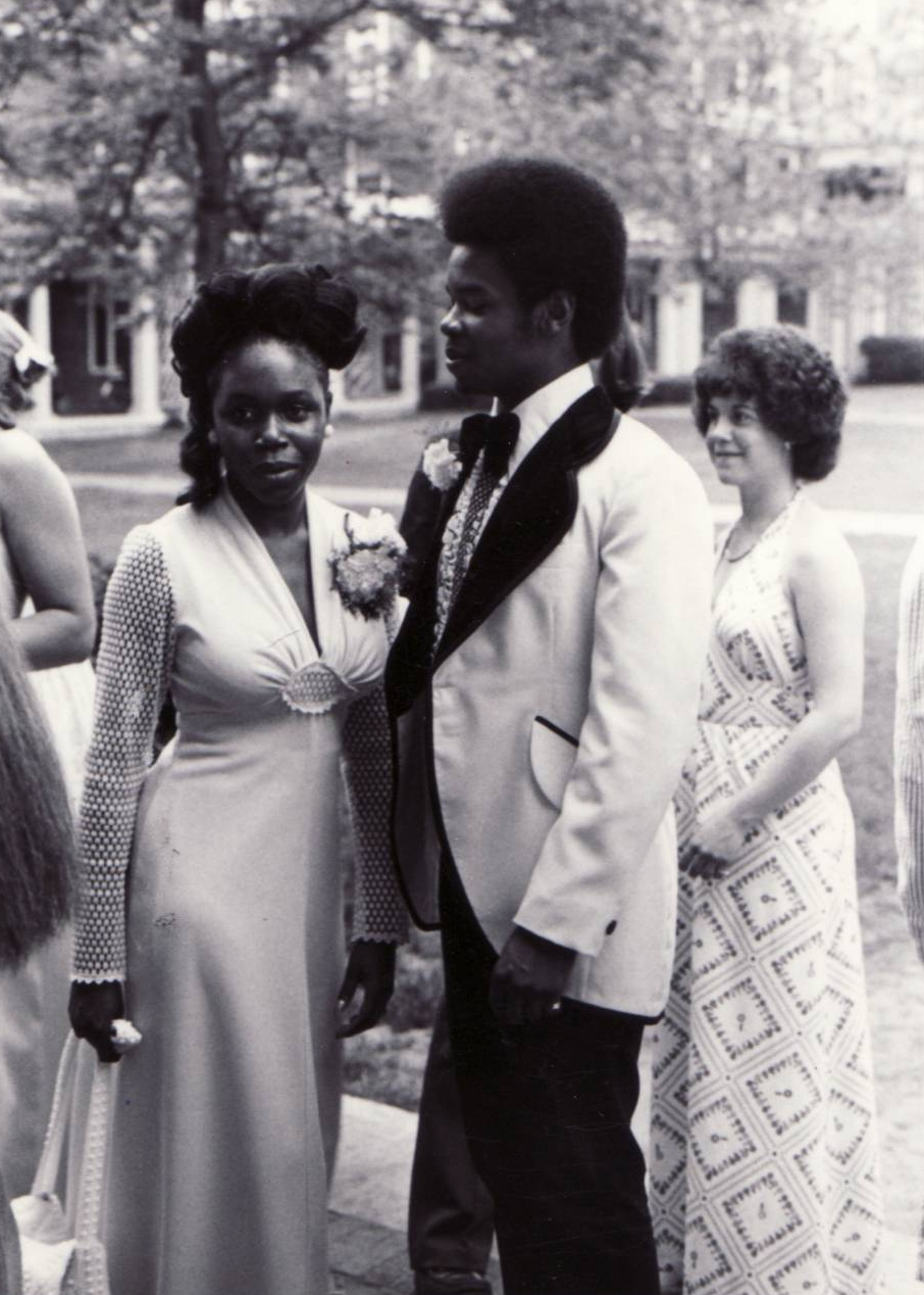 1970's prom style with sheer crochet sleeves and that center medallion we all know and love from the decade.  Found here.