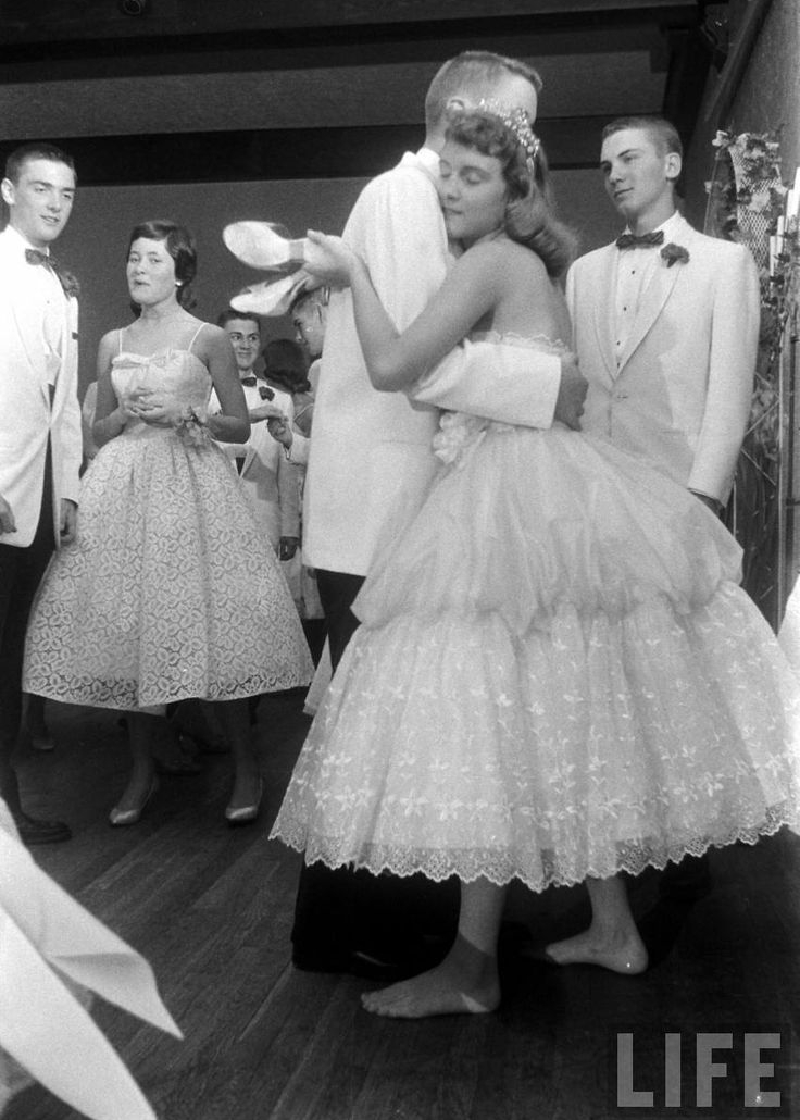 Time Life has an insane image archive. The collection this photo comes from is definitely worth checking out if you're into 1950's prom style.   Found here.