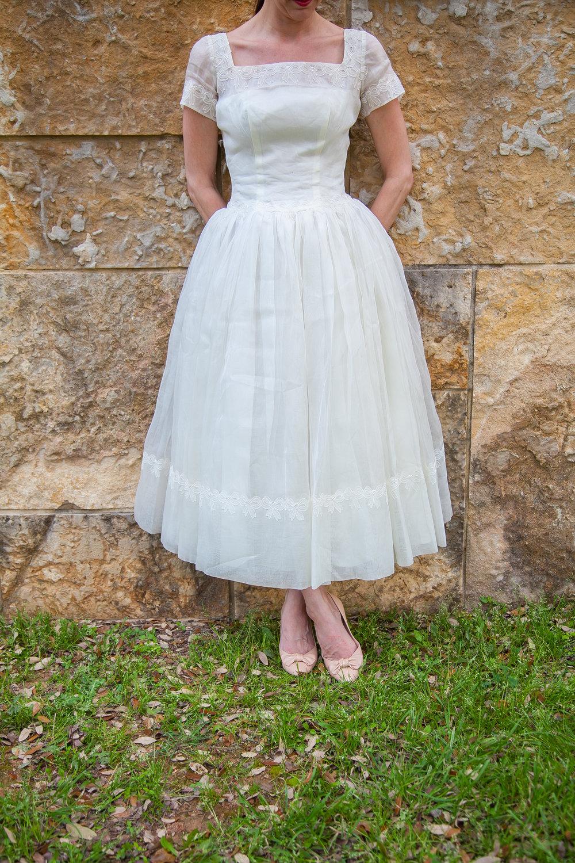 Vintage tea length wedding dress with darling bow details from Dalena Vintage Bridal.