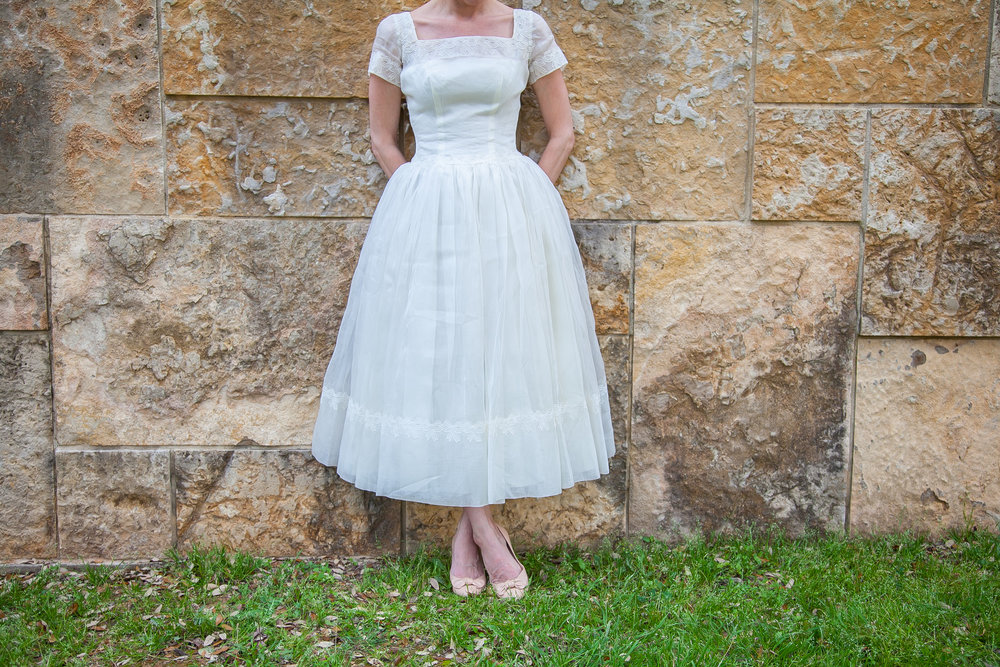 Vintage tea length wedding dress with sleeves from Dalena Vintage Bridal.