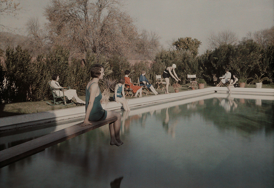 People relax beside a swimming pool at a country estate near Phoenix, Arizona, 1928. PHOTOGRAPH BY CLIFTON R. ADAMS, NATIONAL GEOGRAPHIC CREATIVE