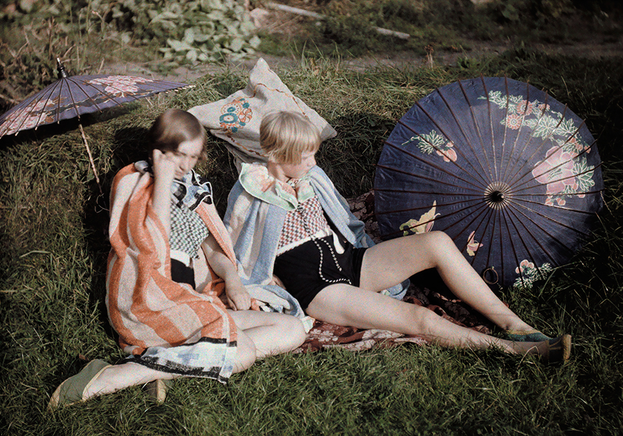 Two young girls enjoy the sun relaxing in their suits and wraps in England, September 1929. PHOTOGRAPH BY BERNARD WAKEMAN, NATIONAL GEOGRAPHIC