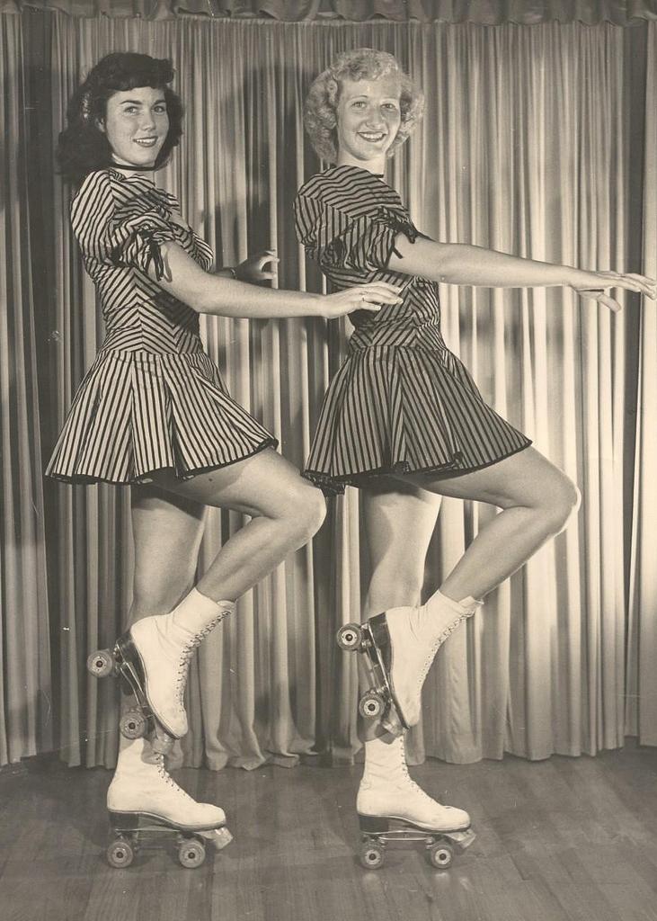 Vintage gals roller skating in striped skirts.