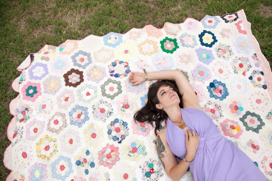 Antique quilts and vintage dresses. Yes, please!