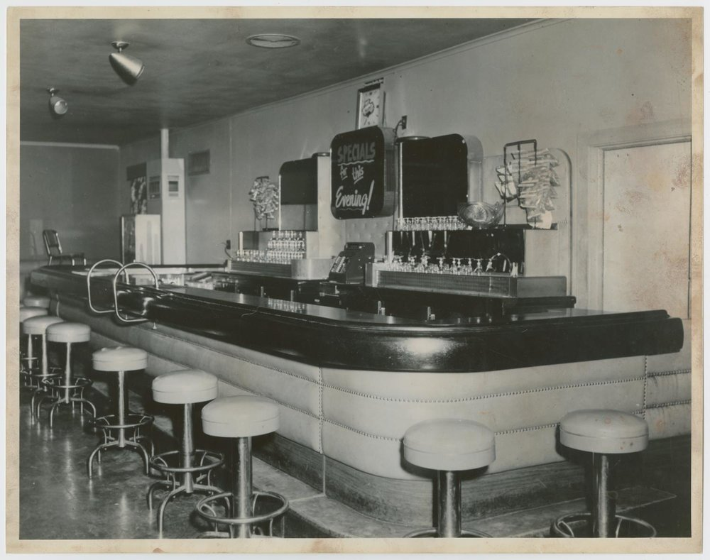 The bar at the non-commissioned officers mess at Bergstrom's Air Force Base in 1956. Wish I could tell what was on tap!
