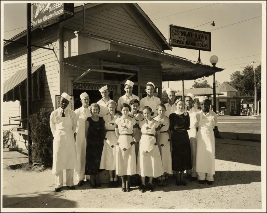 Staff at the Night Hawk in Austin, Texas on October 8, 1935. Such great logos on the waitresses uniforms!