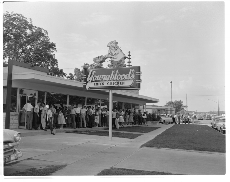 Customers lined up outside of the Texas chain, Youngblood's Fried Chicken on Lamar. Love their signage, wonder if it still exists somewhere!?