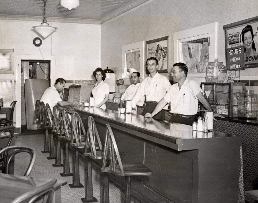 Staff of Victor's Italian Village Restaurant behind the bar. The restaurant was located at 409 West 23rd Street in Austin, Texas.