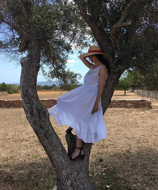 DV customer exploring France in her 1980's summer dress from the shop.