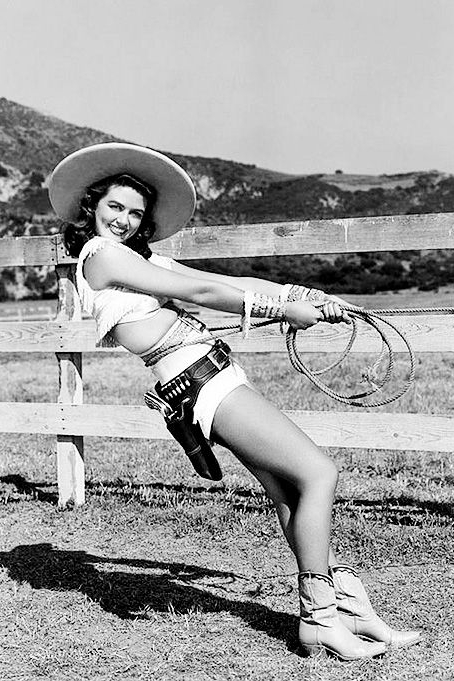 Get inspired with these vintage Halloween costume ideas. How about the classic cowgirl pinup?