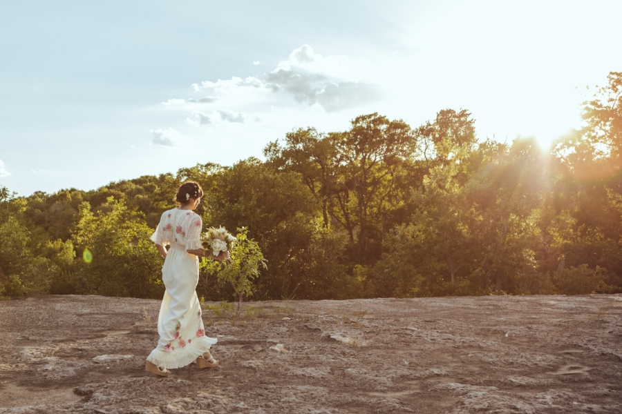Walking up to the ceremony, a natural aisle of moon-like terrain in platform wedges is a difficult task indeed. Not for the faint of heart, especially in nearly 100 degree Texas heat!