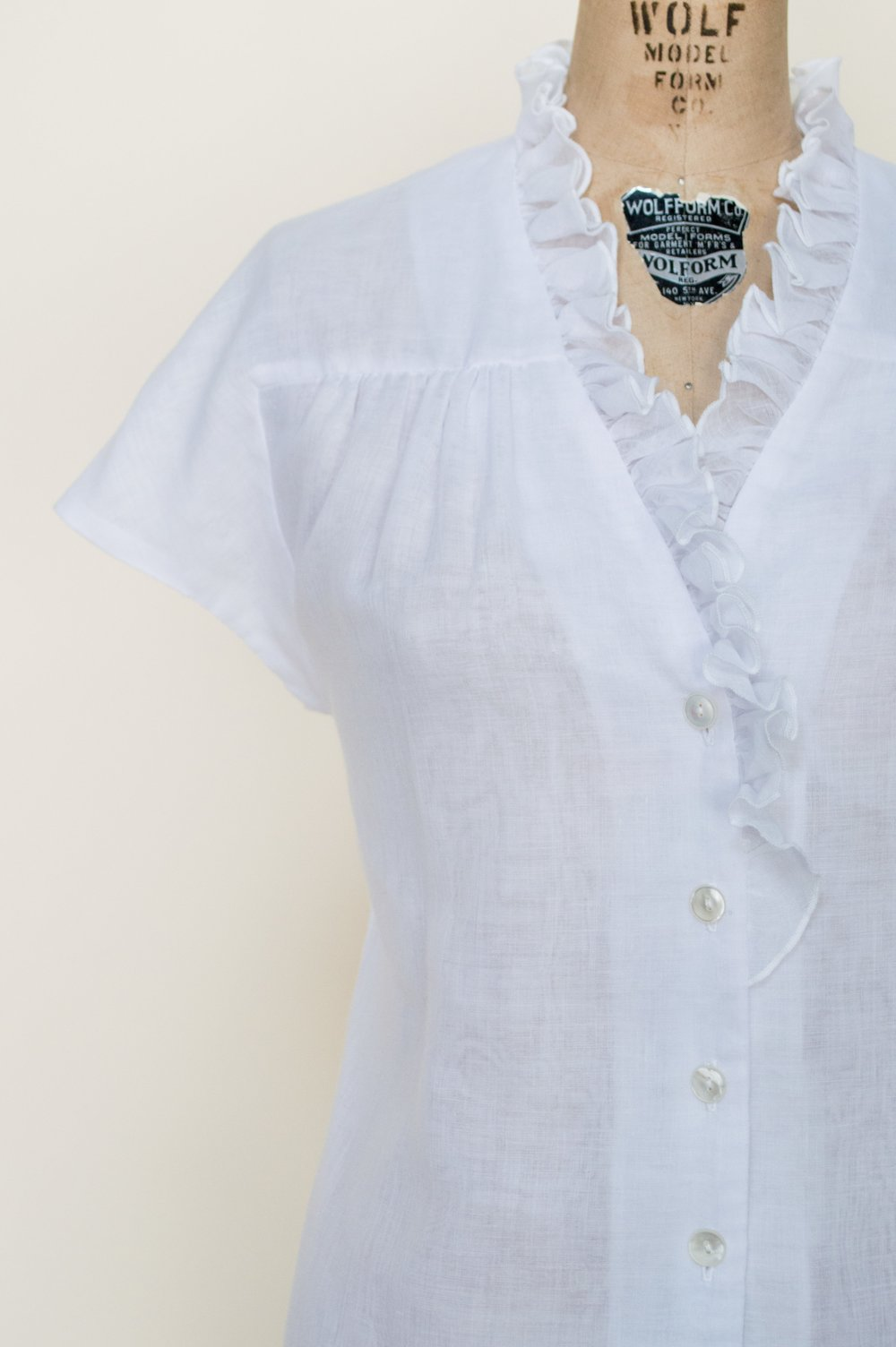 1970s white ruffle top from Dalena Vintage