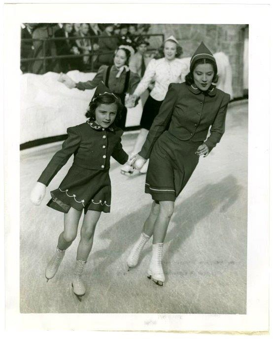 A woman and girl ice skating in the 1930s or 1940s. So stylish!
