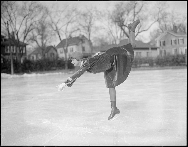Vintage photo of a woman ice skating.