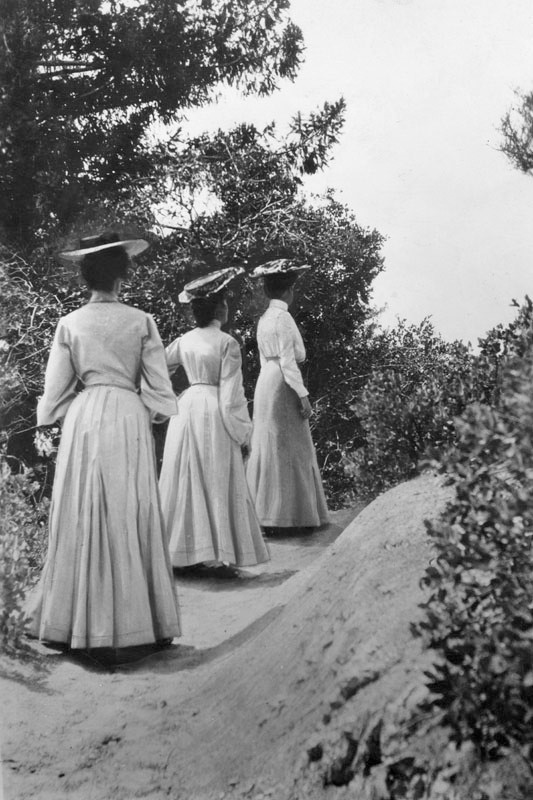 "Vintage Camping Photos /// Vintage photo from 1902 with a caption that reads, ""'Ah, there!' Behold, three young ladies of fashion determinedly, though circumspectly, hiking up the Mt. Lowe trail in the year 1902. Mountaineering was quite the thing in those halcyon times, but if anyone had so much as mentioned hiking outfits with 'shorts' to these gals, they probably would have hidden their blushes in the shrubbery."""