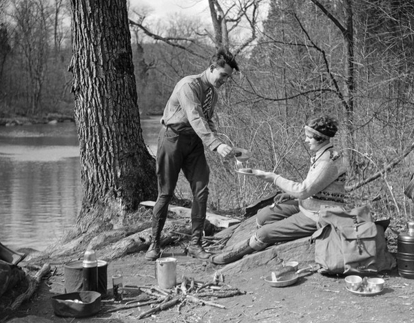 Vintage Camping Photos /// Couple enjoying a camp meal near the river, 1920s.