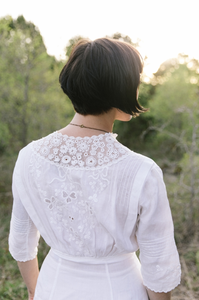 Beautiful lace and embroidered detailing on the back of this Edwardian lawn dress.