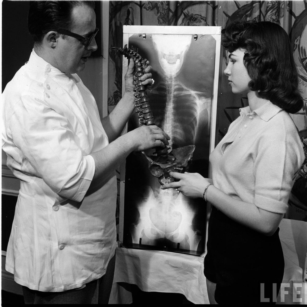 Examine a spine at the Miss Correct Posture contest. Chicago, May 1956