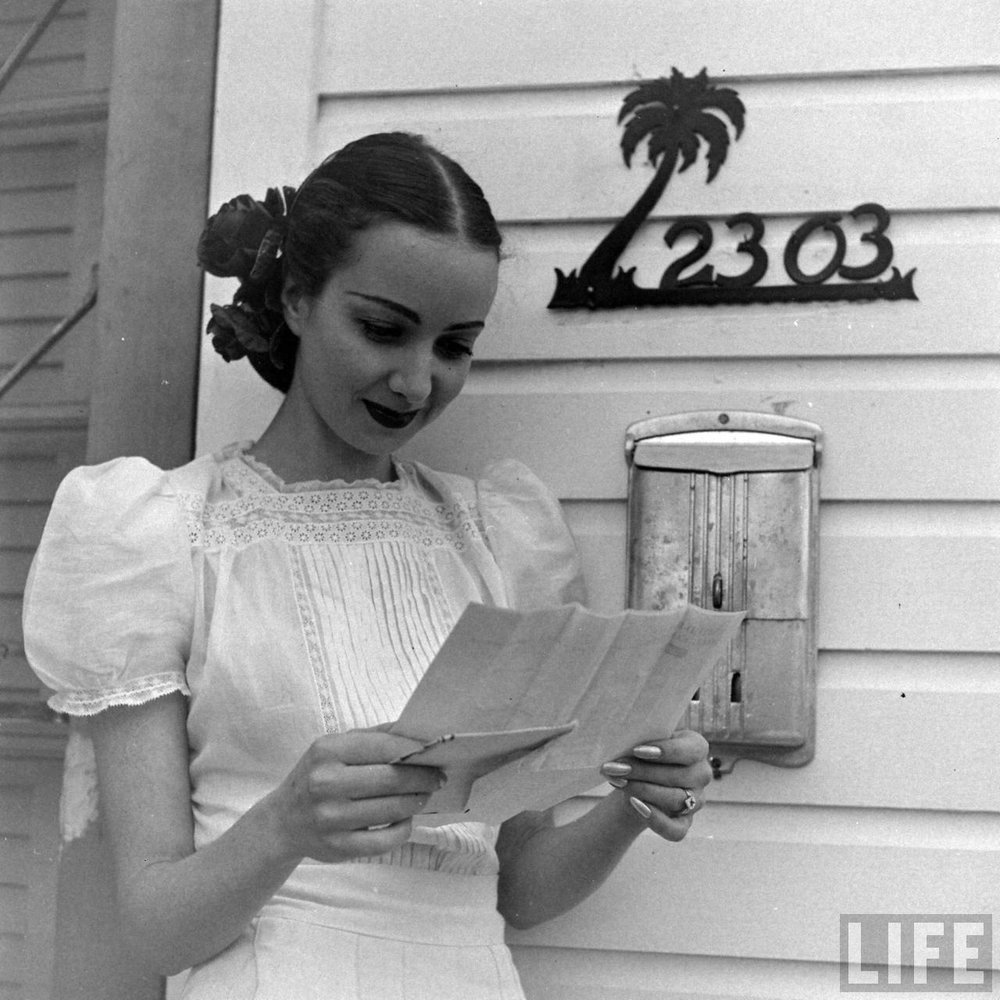 Florida showgirl reading her mail. Florida, 1947. Via Time Life Archives.