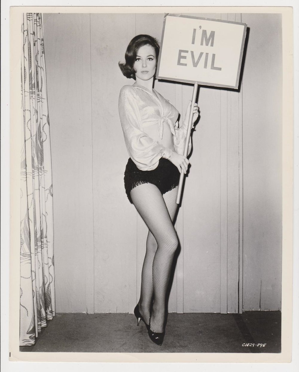 I'm Evil! Vintage photos of women and signs.