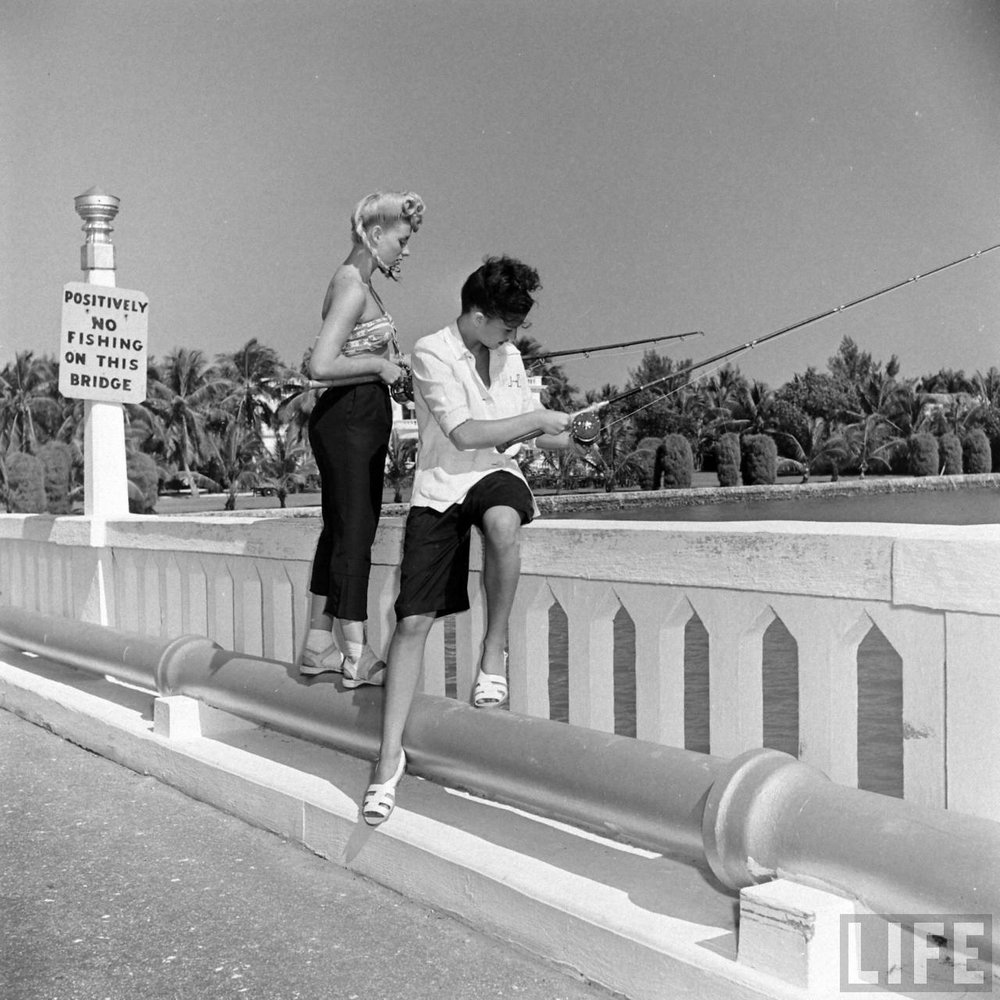 Two showgirls fishing off a bridge in Florida, 1947. Via Time Life Archives.