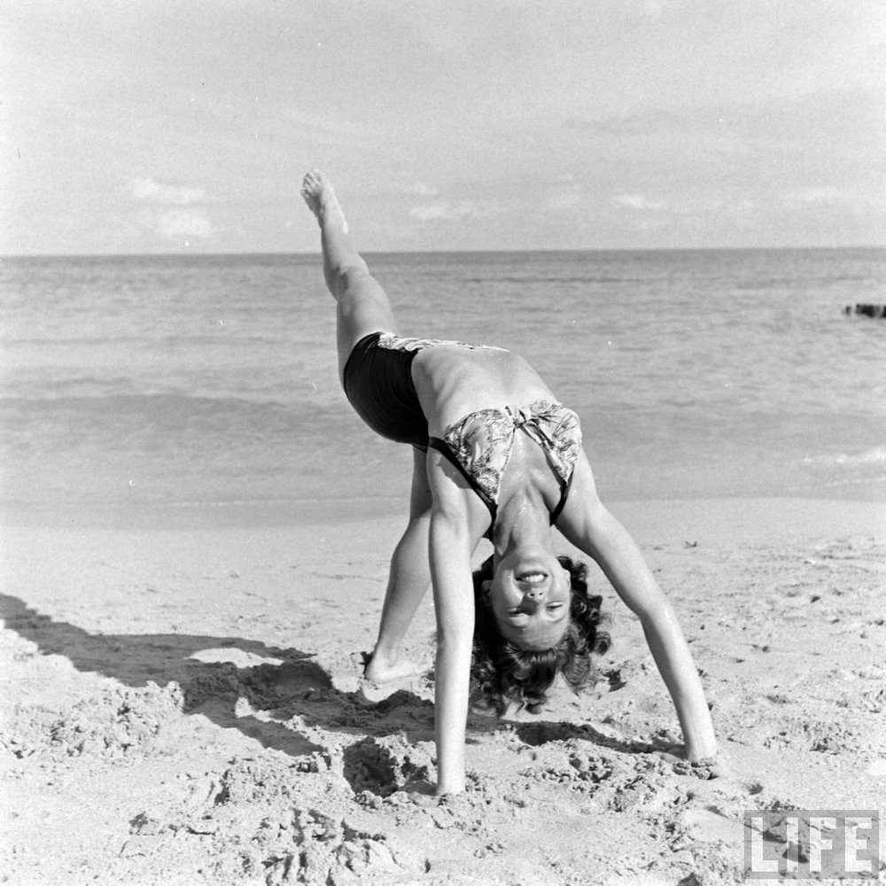 Florida showgirl doing a backbend at the beach, 1940s. Via Time Life Archives.