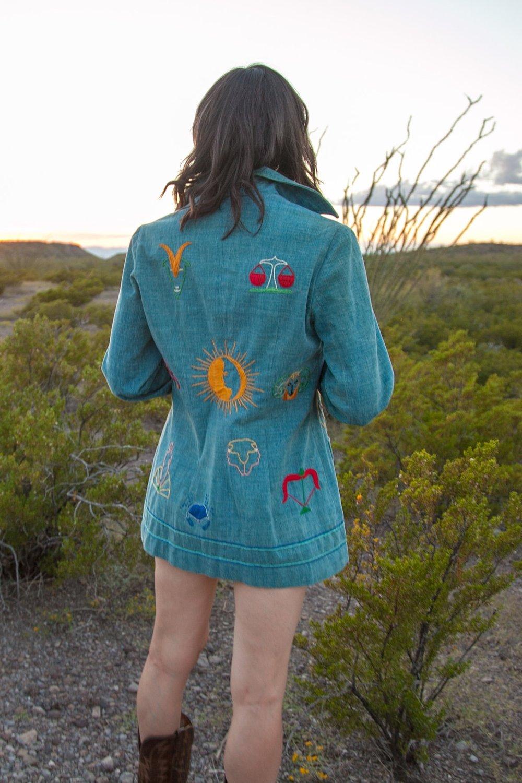 1970s zodiac denim jacket from Dalena Vintage.