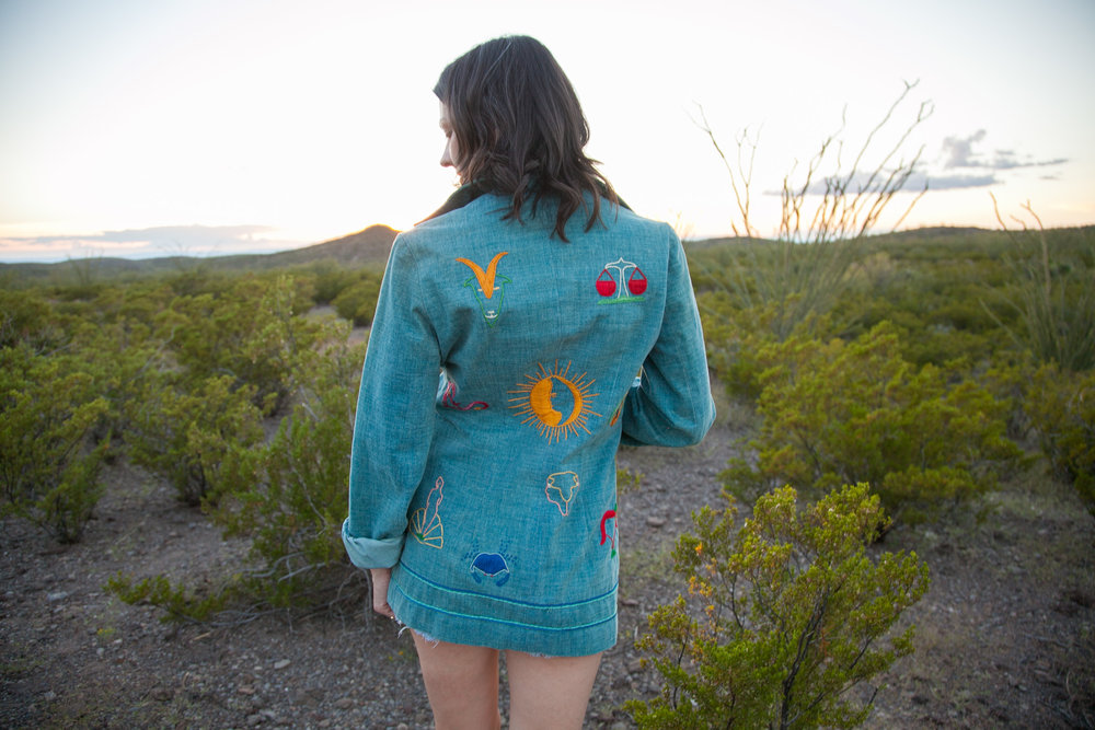 Exploring Big Bend Ranch State Park in a 1970s embroidered jacket from Dalena Vintage.