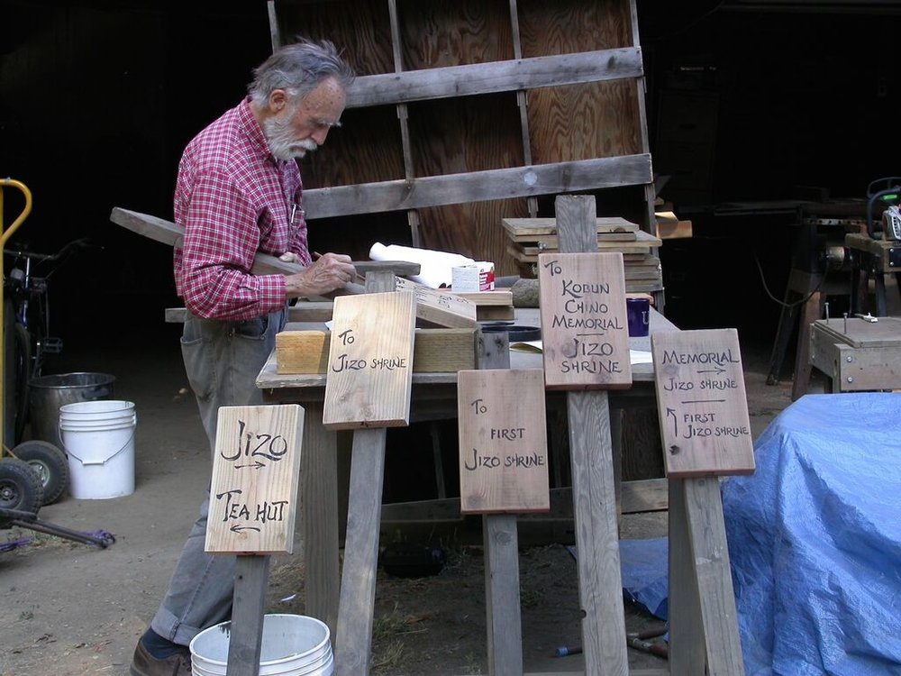 Gerow crafting signs for the Jikoji grounds.