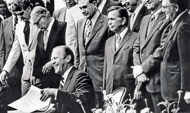 President Gerald Ford signing ERISA into law