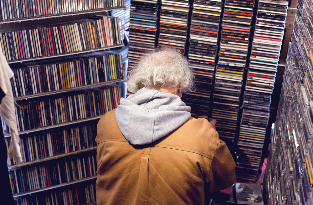 A young man peeps some CD's