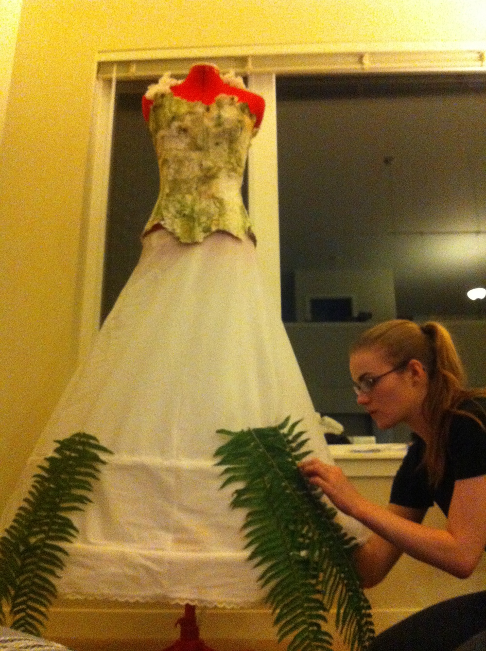 Meredith and I gluing on the very first ferns to the skirt.