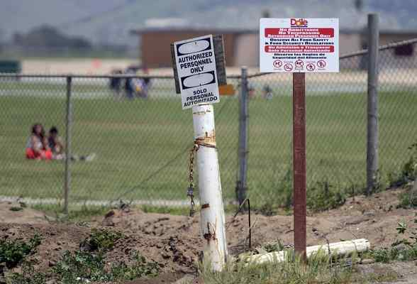 A sign in an agriculture field adjacent to Gavilan View Middle School in Salinas warns of nearby pesticide application in May 2014. (David Royal - Monterey Herald)