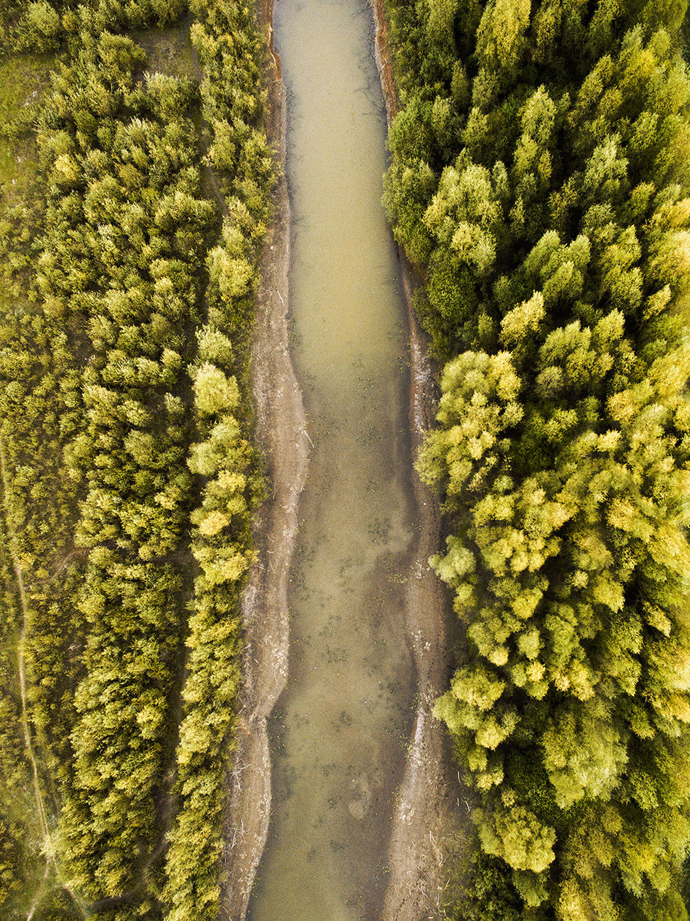 Kanaal (2018)    Kanaal  is a series of carefully selected aerial landscape photographs captured above canals of Overijssel, The Netherlands. You can read more about the series  here .