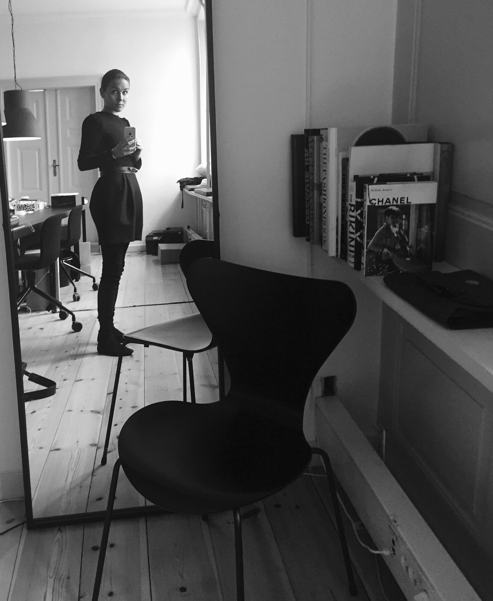 Dress by other stories, chair by Arne Jacobsen, mirror by Broste