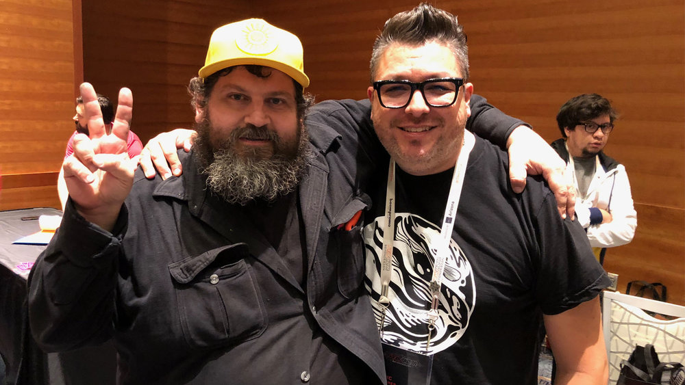 Portland's  Aaron Draplin . All around good guy. (A heavy paw keeping me on the ground there.) Also, our design friend  Kevin Varela  = photobombin' with style!