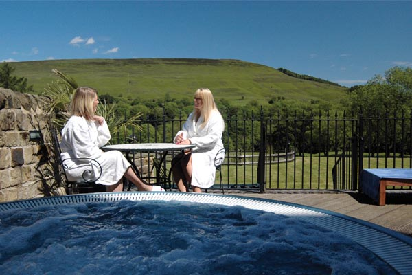 Relaxing by the hot tub at Losehill House Hotel and Spa