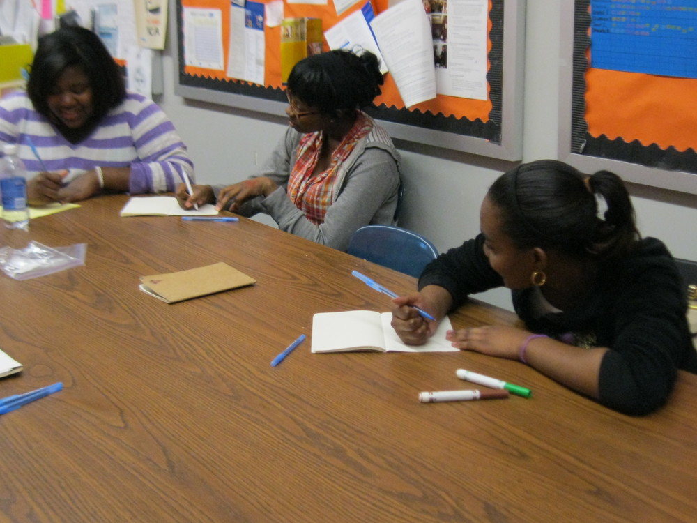 students writing at Parachute's weekly writing workshop at the YWCA Teen Empowerment Program .jpeg