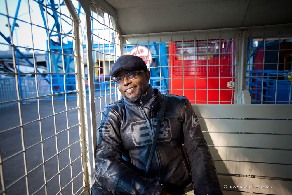 Pulitzer Prize winning poet, Tyehimba Jess on Deno's Wonder Wheel in Coney Island for Parachute Literary Arts event, Poem-a-Rama, May 2015 (Photograph by Raymond Adams)
