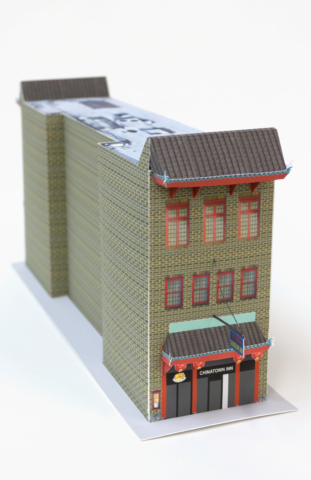 Pittsburgh's Chinatown - This is a DIY paper craft model of 520 Third Ave, the only remaining building with a physical trace of this city's historic Chinatown.Pittsburgh's Chinatown formed in the late 1800's, a small part of the large migration of people traveling west during the Gold Rush. At its height in the 1920s, some 500 residents and 25 businesses called Second and Third Avenues between Ross and Grant Street their home. Chinatown's decline is due in part because the construction of the boulevard of the Allies that bisected the neighborhood.Download and build your own here.